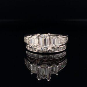 #R100-972500 2.00 CTW Engagement Ring 0.72ct Emerald Cut Diamond G Color SI1 Clarity .48cts of Emerald Cut Diamonds sides 6 princess cut diamonds setting baguettes band