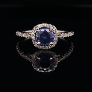 This Diamond Halo Engagement ring features a 1.00ct Round Blue Sapphire and is available for only $1500!!! Inquire Now!!
