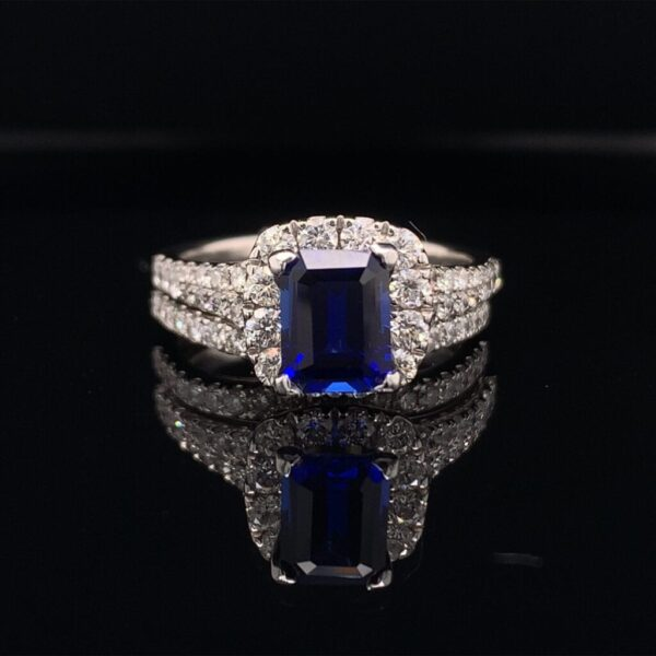 This Stunning Neil Lane Engagement ring and Band features a 1.50ct Emerald Cut Blue Sapphire and has an additional 1.50cts in the ring and band!!! This Bridal set is available for only $4500!!! Inquire Now!!!